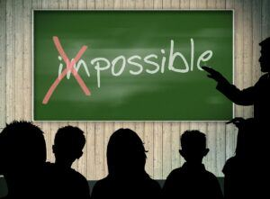 the word impossible on a chalkboard with the 'im' crossed out so it says possible