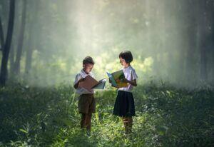 Children reading in forest