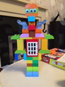 Large Lego Duplo robot with googly eyes