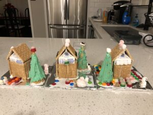 three homemade gingerbread houses