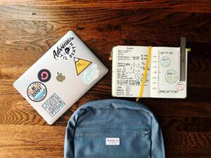bullet journal, back pack, laptop
