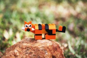 Lego sabertooth tiger on rock