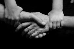black and white connected hands