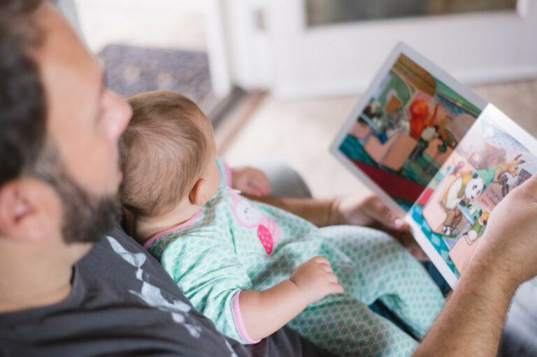 Dad reading baby a bedtime story